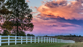 After the Storm. The setting sun fills the passing storm clouds with beautiful light Royalty Free Stock Image