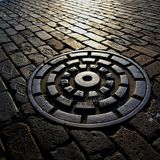 A storm sewer cover Royalty Free Stock Image