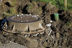 Storm sewer drain and water sprinkler exposed in construction Royalty Free Stock Photos