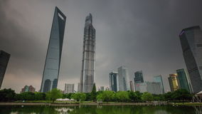 Storm shanghai downtown buildings park pond panorama 4k time lapse china. China storm sky famous shanghai downtown buildings park pond panorama 4k time lapse stock video