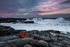 Storm on the shores of the Arctic Ocean at sunset Stock Photography