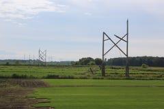 Storm skadade elektriska Poles Royaltyfria Foton