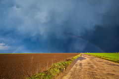 Storm sky and rainbow Stock Photos