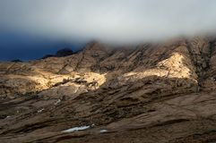 Storm sky and sunlight in desert mountains Royalty Free Stock Photos