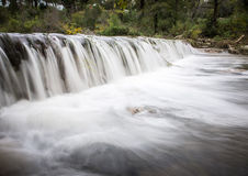 After the storm. A small creek flows heavily after some heavy rain royalty free stock photo