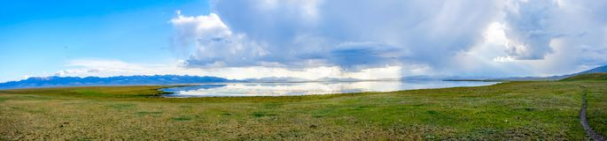 Storm with sunrays over Song Kul lake. Storm with sun rays over beautiful mountains by Song Kul lake, Kyrgyzstan Royalty Free Stock Photos