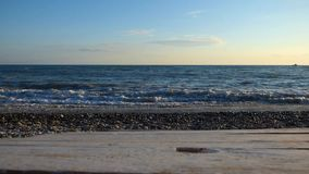 Sea beach with stones and pebbles, big water waves braking stock footage