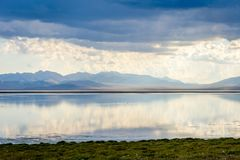 Storm with sunrays over Song Kul lake. Storm with sun rays over beautiful mountains by Song Kul lake, Kyrgyzstan Stock Images