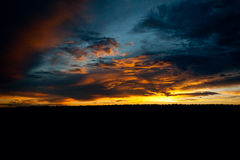 Storm at Sunset. A storm approaches as the sun sets over the grand canyon Stock Image