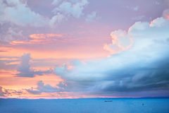 Storm at sunset. A seaside storm rolls in aat sunset, pastel colours Royalty Free Stock Image