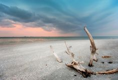 Storm at sunset. On a tropic beach Royalty Free Stock Photos