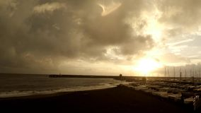 The harbour at the sunset while it rains. The storm at sunset . It rains during sunset stock footage