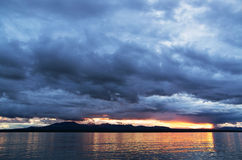 Storm sunset. Sea, coast and the sky on a sunset before a storm Royalty Free Stock Photography