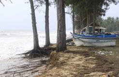 Storm surf at fishing village. In rain season Royalty Free Stock Images
