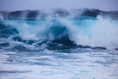 Storm surf surges against Oahu shore Royalty Free Stock Image