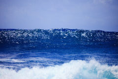 Storm surf surges against Oahu shore. Storm surf from an approaching hurricane pounds the eastern shore of Oahu, Hawaii the day before the storm arrives Royalty Free Stock Image