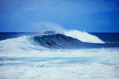 Storm surf surges against Oahu shore. Storm surf from an approaching hurricane pounds the eastern shore of Oahu, Hawaii the day before the storm arrives Royalty Free Stock Photography