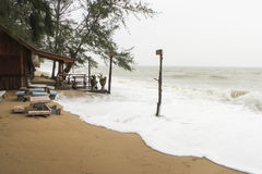 Storm surf swash to shore. In the rain season Stock Images