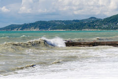 Storm surges and breakwater. Stormy weather Royalty Free Stock Images