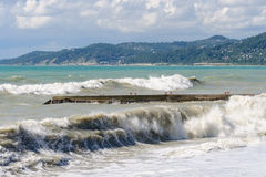 Storm surges and breakwater. Stormy weather Royalty Free Stock Image