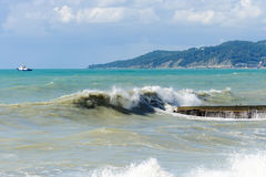Storm surges and breakwater. Stormy weather Royalty Free Stock Photo