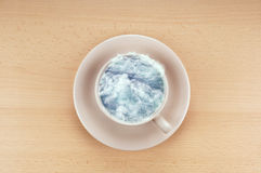 Storm in a teacup. Is an idiom meaning a small event that has been exaggerated out of proportion Royalty Free Stock Image