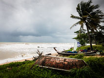 Storm in Thailand. Stormy scene on the beach in Thailand blows the coconut trees and whips up the sea Royalty Free Stock Photo