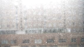 Storm with thunders and rain with blurred building