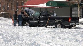 winter storm  help  teamwork Stock Photos
