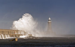 Storm at Tynemouth. A powerful wave crashes over Tynemouth south pier during a storm Stock Photo