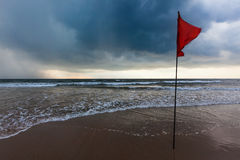 Storm warning flags on beach. Baga, Goa, India Stock Photos