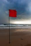 Storm warning flags on beach. Baga, Goa, India Royalty Free Stock Photography