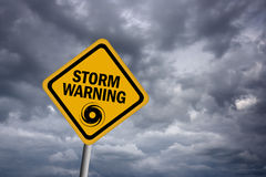 Storm warning sign. Over dark sky Royalty Free Stock Photo