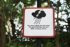 Storm warning sign in a park Stock Photo