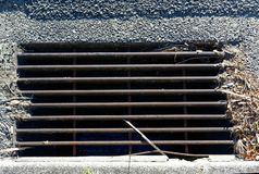 Storm water drain on road stock photo