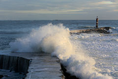 Storm wave over pier Royalty Free Stock Photography