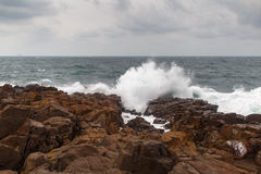 Storm wave and rocks Stock Photo