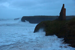 Storm waves at Ballybunion castle and cliffs Royalty Free Stock Photo