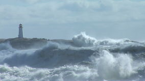 Storm waves breaking against rocks stock video footage