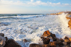 Storm waves crash against the rocks Royalty Free Stock Photo