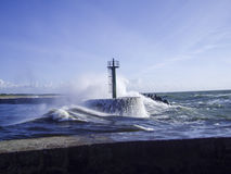 Storm. Waves crashing out about breakwater Stock Images