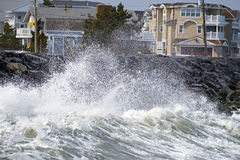 Storm Waves Crashing on Seawall Stock Photos