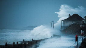 Storm waves hitting coastline Stock Images
