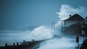 Storm waves hitting coastline. Storm Imogen creating massive waves hitting the UK / United Kingdom coastline at Tywyn, Wales, higher than a house stock images