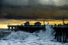 Storm waves on ocean pier Stock Images