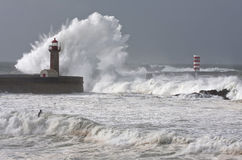 Storm waves over the Lighthouse. Portugal - enhanced sky Stock Photography