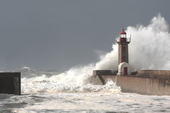 Storm waves over the Lighthouse. Portugal - enhanced sky Stock Image