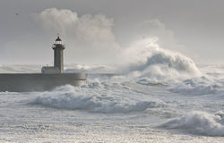 Storm waves over the Lighthouse. Portugal - enhanced sky Stock Images