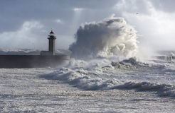 Storm waves over the Lighthouse. Portugal - enhanced sky Royalty Free Stock Photos