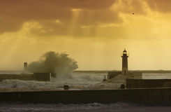 Storm waves over the Lighthouse. Portugal - enhanced sky Royalty Free Stock Image